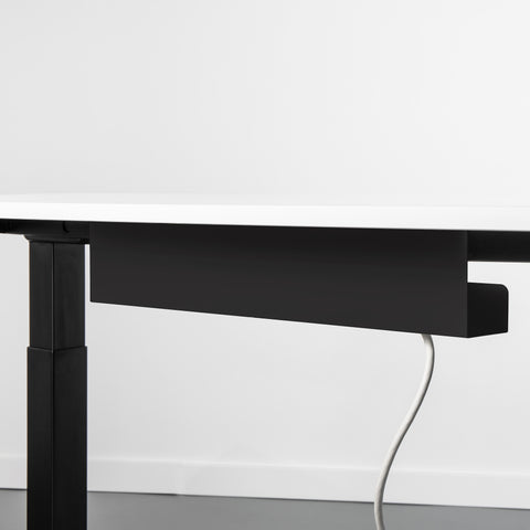 Black Cable management holder attached to the underside of a sit stand desk