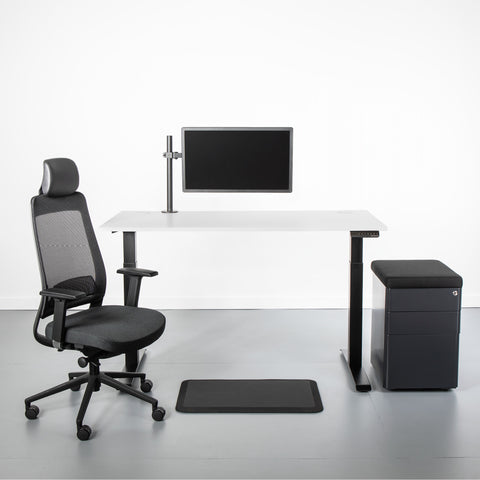 Desk setup with adjustable stand up desk, monitor mount, computer chair, anti-fatigue mat, office storage unit and cable hider