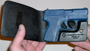Wallet style top covered back pocket holster for licensed concealed weapon carry of Kahr PM9