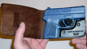 Wallet style top covered back pocket holster for licensed concealed weapon carry of Sig Sauer P290