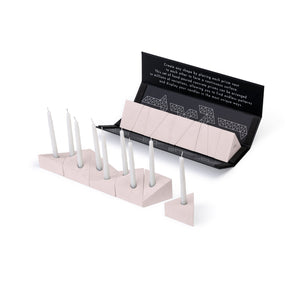 Logifaces concrete puzzle, 9 pieces, packaging & line made of puzzle with candles. Colour: rose.