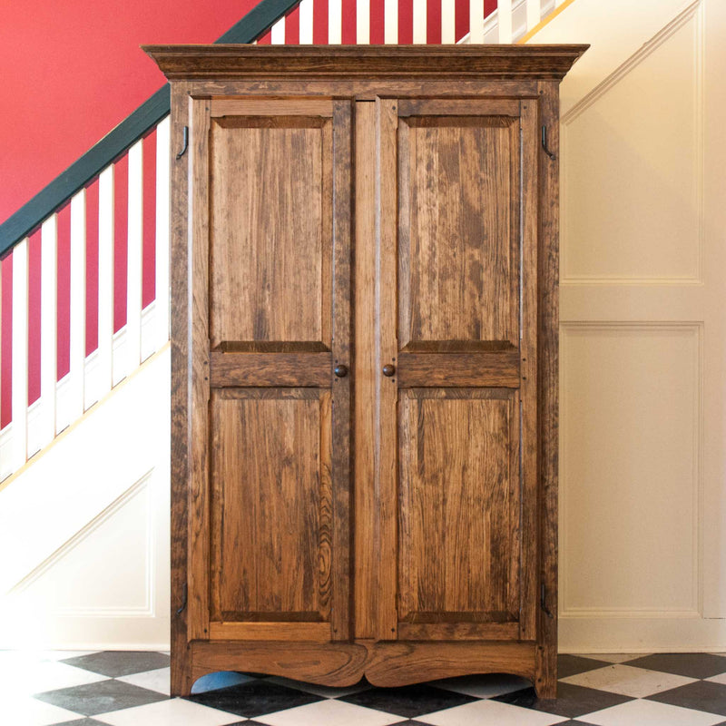 Solid wood raised panel armoire in provincial, direct front, close crop