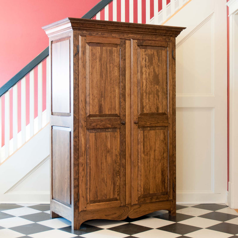 Solid wood raised panel armoire in provincial, angle on, close crop
