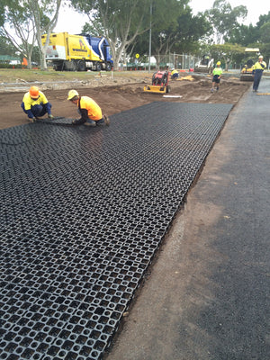 Workers and tradesmen using the drainage cell to create a sustainable gravel driveway.
