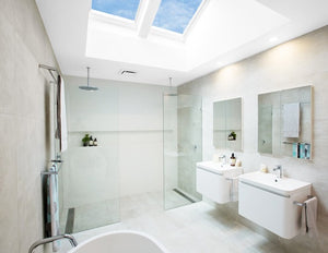 Naturally light bathroom using Velux pitched skylights
