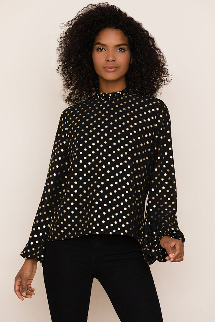 Yumi Kim's Candle Light metallic polka dot top can easily take you from day to night.