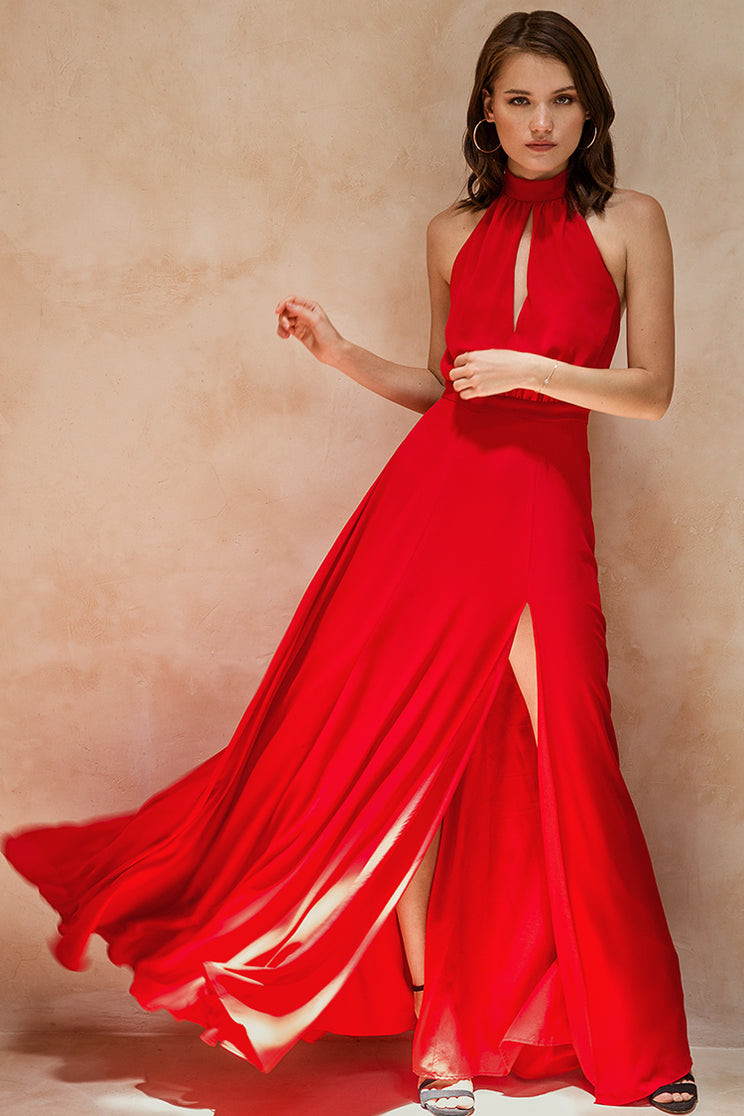 Meet Yumi Kim's red high neck maxi dress. Details include a choker neck tie, open seam at center front, open back, high slit, and hidden back zip closure.