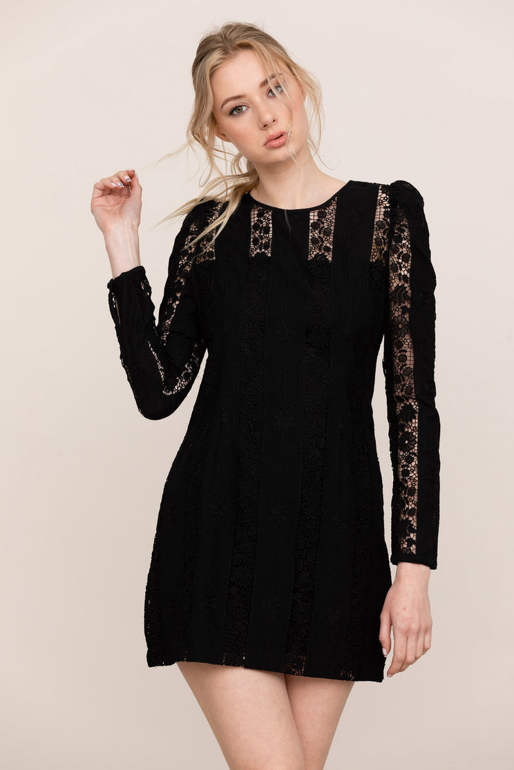 Channel romance in Yumi Kim Good Timing Black Lace MiniDress. Details include crew neckline, long sleeves, shift silhouette, and hidden back zipper.