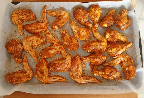 spicy chicken wings on tray