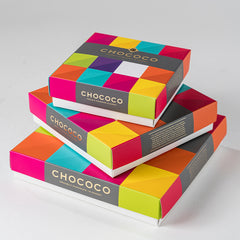 Photograph of multiple Chococo boxes of multiple sizes stacked creatively, available at ChocoCake