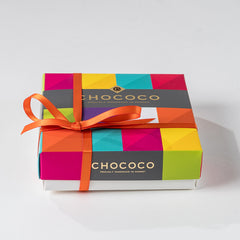 Photograph of a Chococo selection box with a orange ribbon
