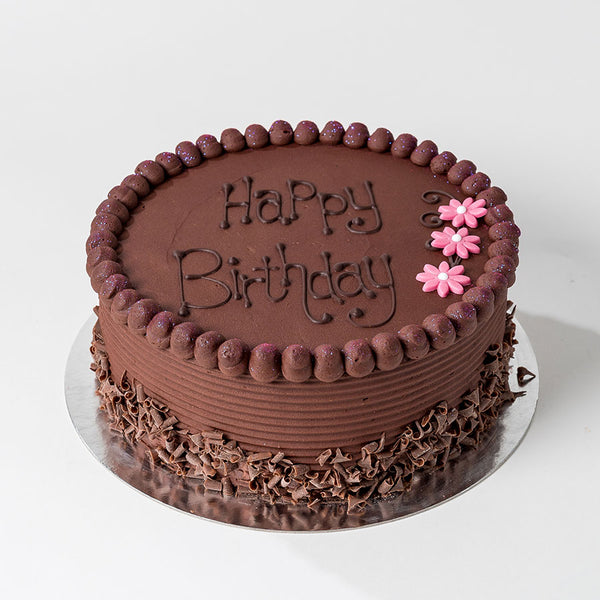 Photograph of a Happy Birthday Chocolate Buttercream Cake with chocolate decoration and personalisation available to order at ChocoCake
