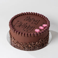Photograph of a round Chocolate Buttercream Cake available to order at ChocoCake with free personalisation and decoration