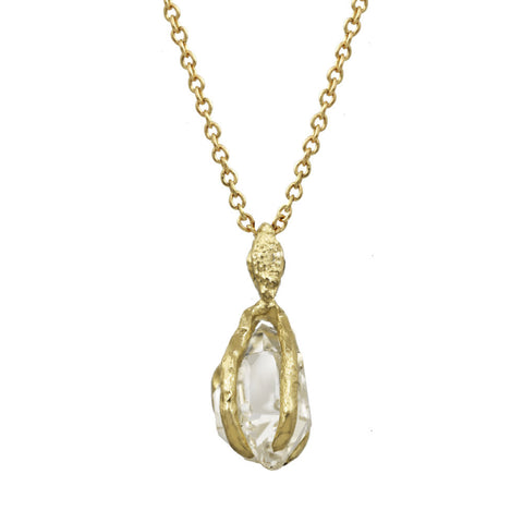 Herkimer Crystal pendant with a gold bail on a gold chain.