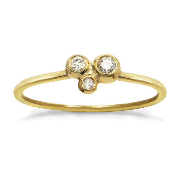Delicate gold ring with three small diamonds in a constellation shape.
