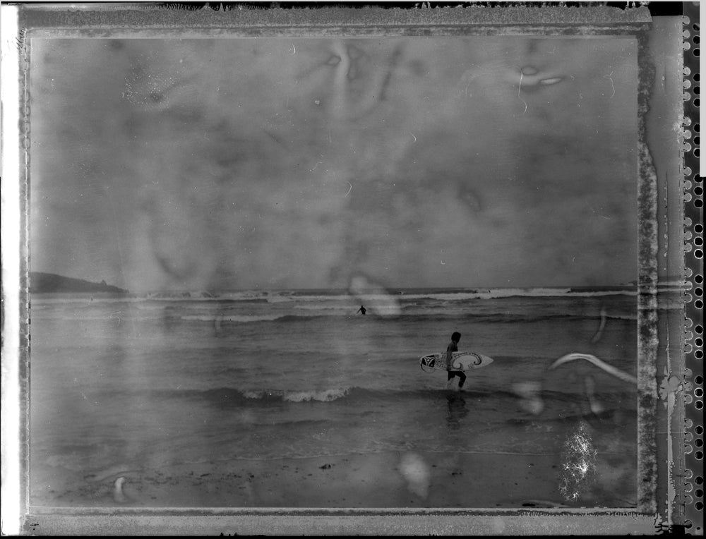 Polaroid image of surfer at Harlyn