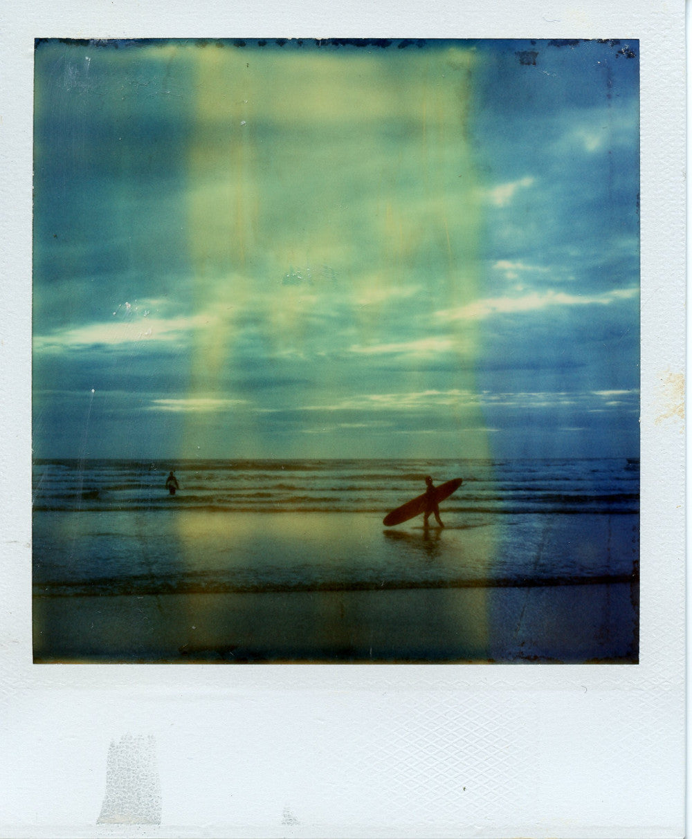 Polaroid photograph of a longboarder at Perranporth