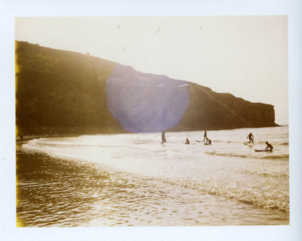 Polaroid image of sunset surfers at St Agnes
