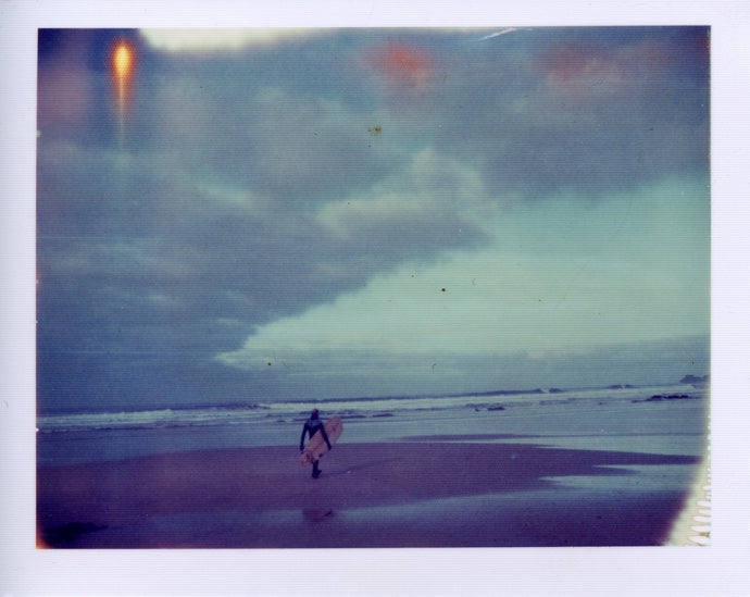 Polaroid of a surfer at Gwithian