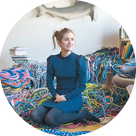 Maker Sophie Aschauer in her home, surrounded by colourful rope.