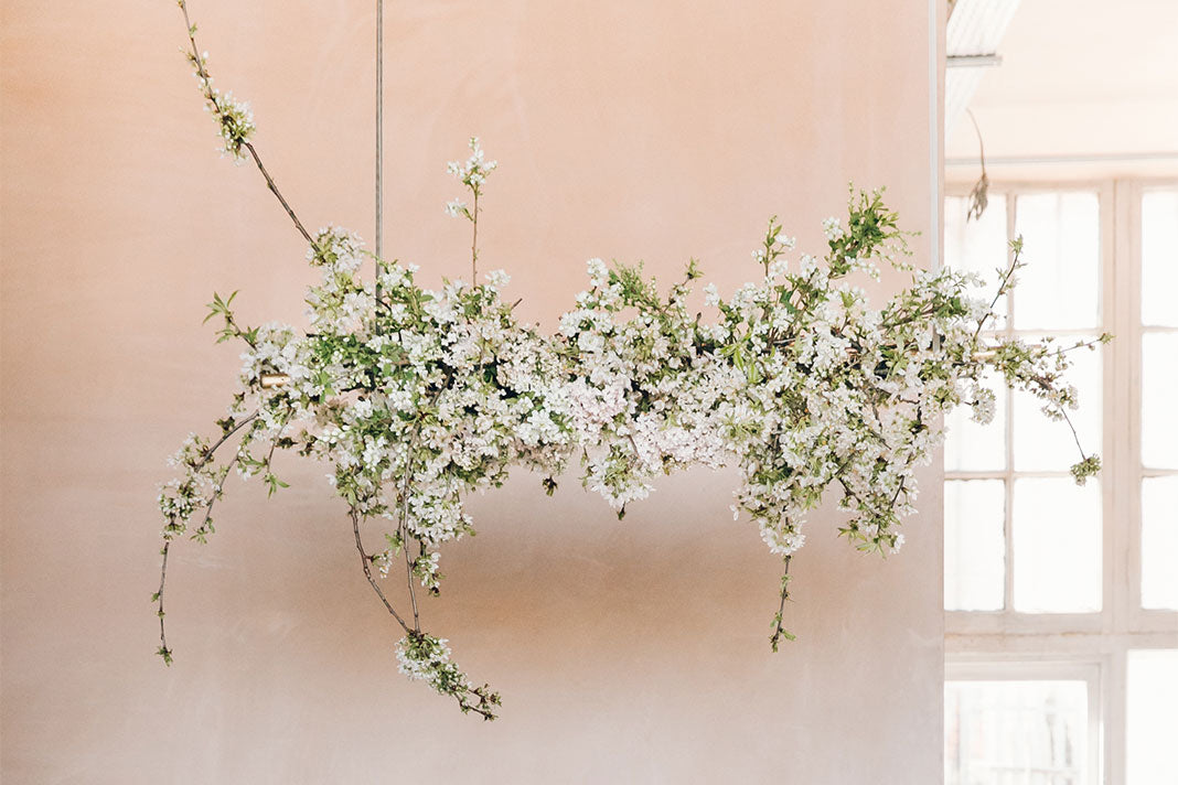 A hanging floral arrangement made with spring blossoms.