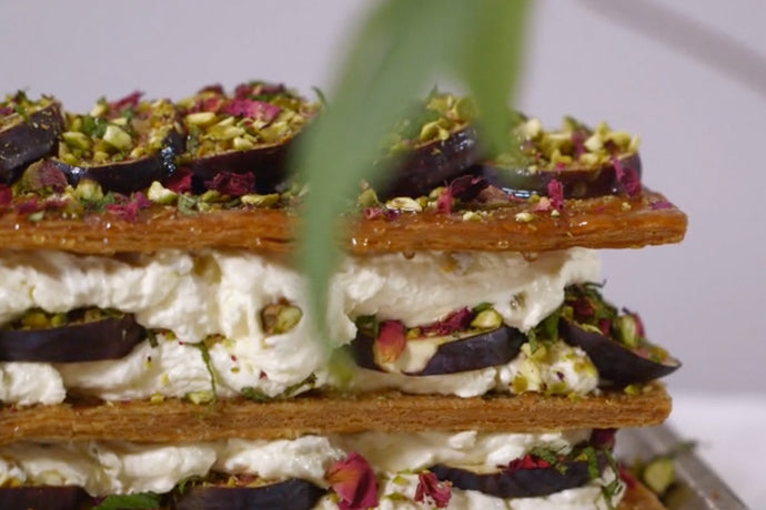 Detail of Fig and Rose Millefeuille, a Middle Eastern pastry layered with black figs and dried rose petals, pistachios, passion fruit and honey cream.