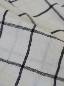 Checked peasant dress with hand-embroidered running stitch