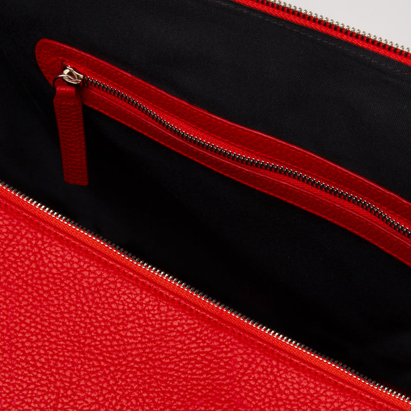 "Weekend travel bag made of red italian leather. Made in Spain. Dimension: 18.5"" L x 11.5"" H x 8.5"" D"