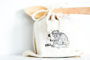 natural cotton bag with toad stamp and wooden spoon
