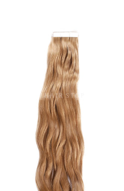 Dark honey blonde tape-in extensions