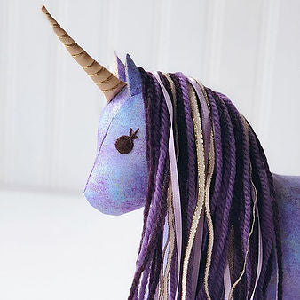 Purple unicorn stuffed animal