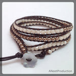 Gold Pearl and Frosted Cream Four Wrap Bracelet