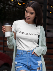 "Young, hip woman, wearing a white tshirt that reads ""animal Lover""."