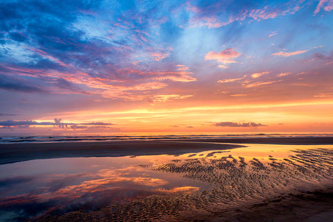 A photo of a beautiful sunrise on the beach in New Smyrna Beach