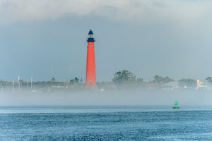 A photo of the Ponce Inlet Lighthouse with sea fog