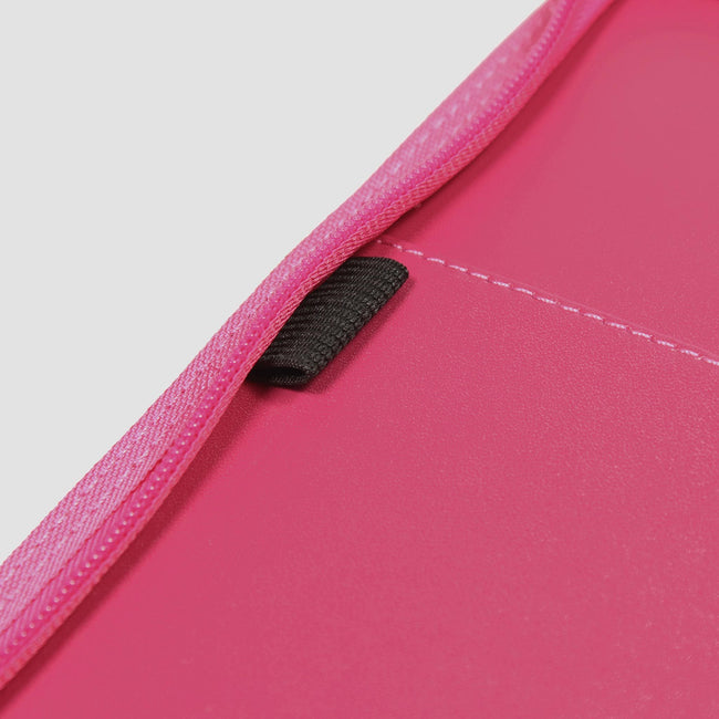 Inside of pink diary cover showing zip and elastic pen loop