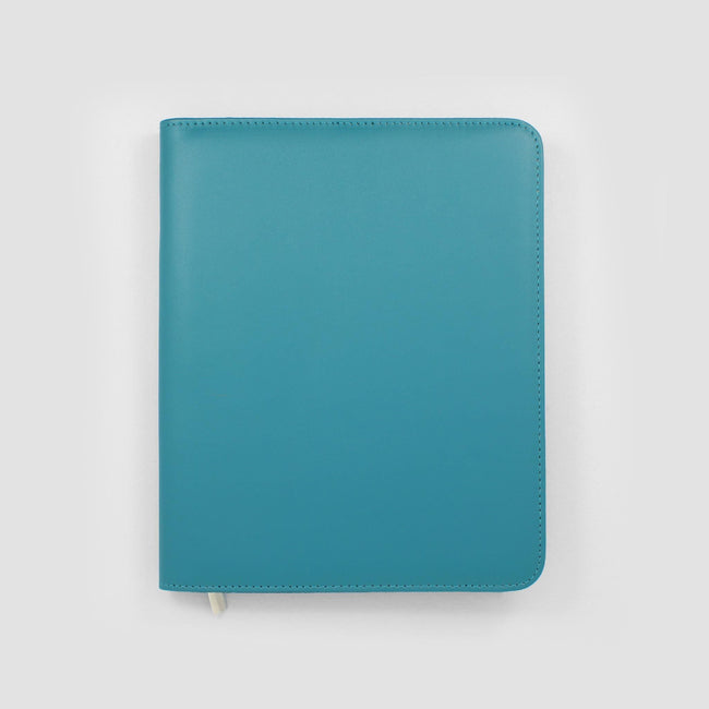 Blue diary cover on a grey background