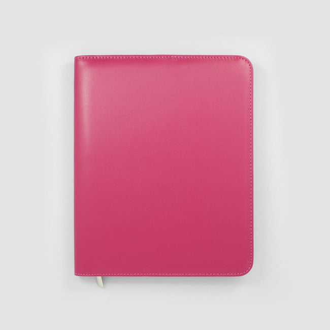 Pink diary cover on a grey background