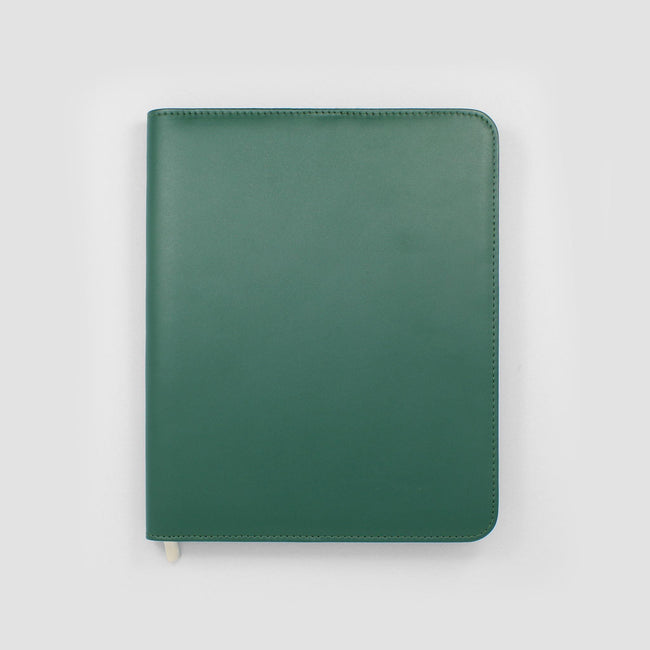 Image of a dark green diary cover on a grey background