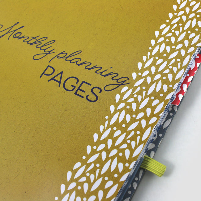 Close focus on the yellow planning tabbed page in the Life Book diary