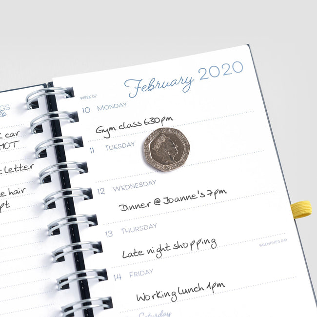 A week to view diary page in the Boxclever Press Pocket Life Book with a coin to show writing space