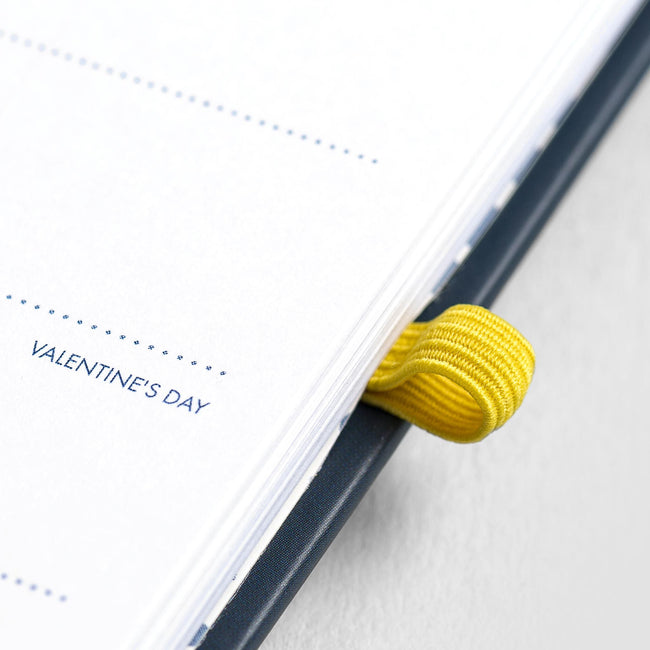 Close up image of yellow elasticated pen loop on the Pocket Life Book 2020 slimline diary