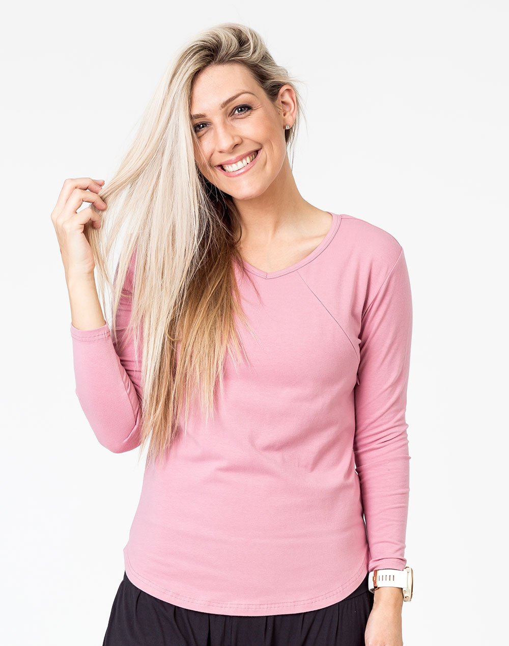 active mum wearing a pink maternity top with long sleeves and invisible zips for breastfeeding