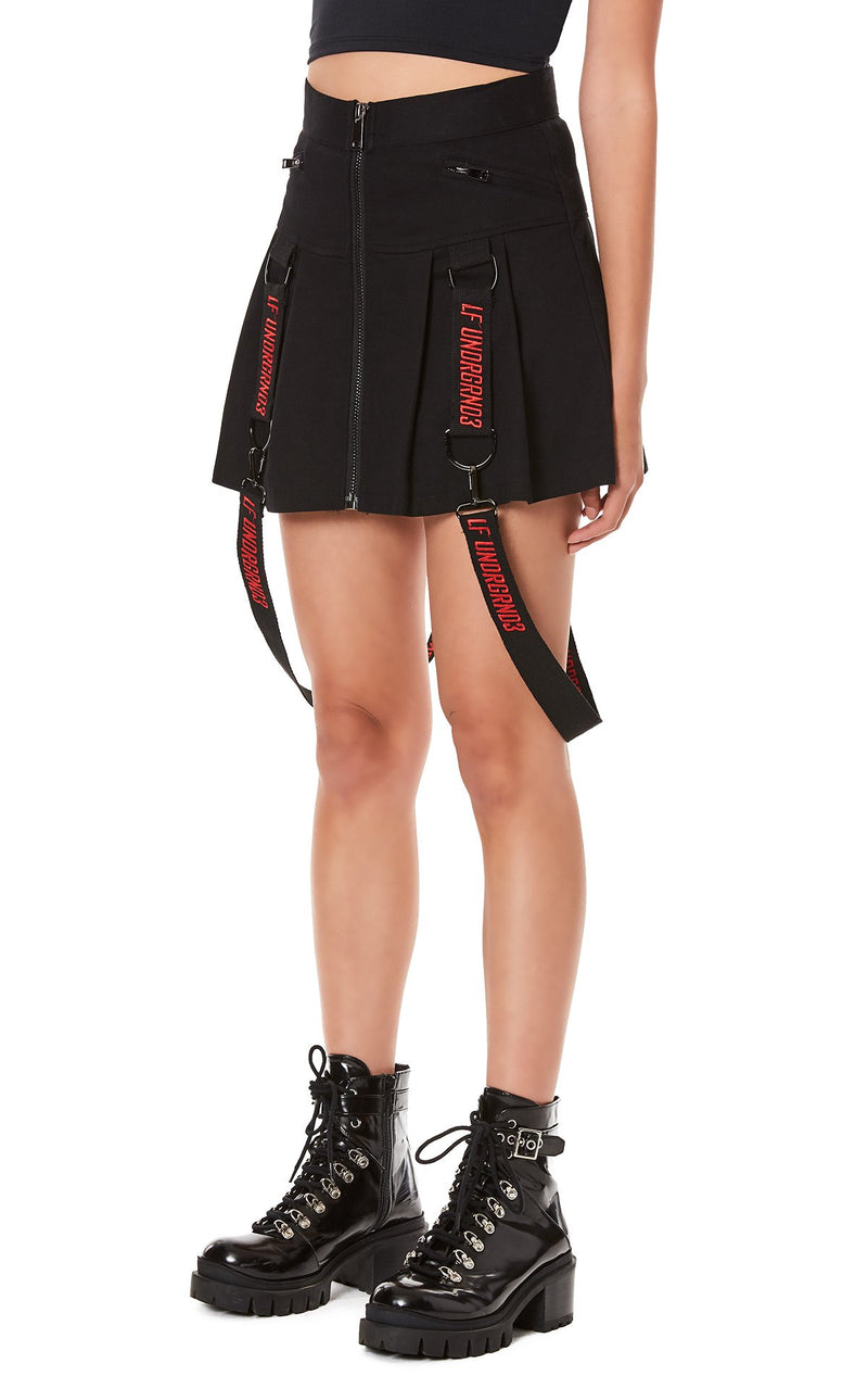 PLEATED ZIP FRONT SKIRT WITH SUSPENDERS ANGLE