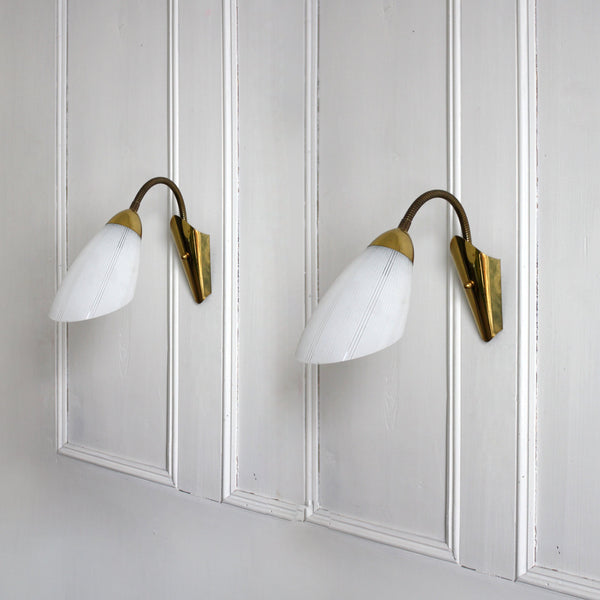 1950s mid-century modern gooseneck wall sconces in brass, white glass