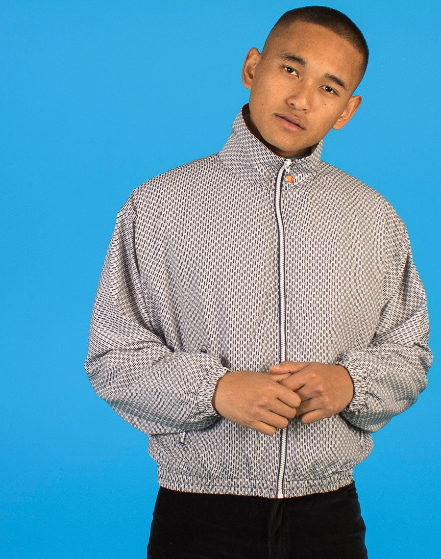ELLESSE PATTERNED TRACK JACKET