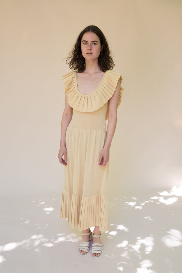 Yellow pleated scoop neck dress by Hesperios