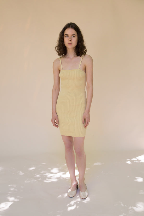 Yellow ribbed knit mini dress by Hesperios