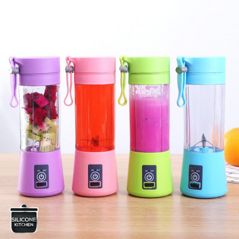 Four USB Portable Blenders with fruit and juice inside the clear cup. One Green, One Blue, One Pink, One Purple