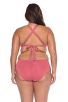 Model posing in the BECCA ETC Color Code Women's Pink Baked Blush Bralette Bikini Top